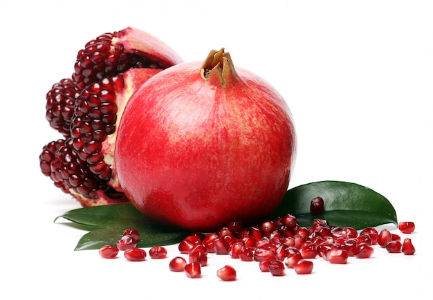 Exotic and delicious pomegranate on white background Free Photo