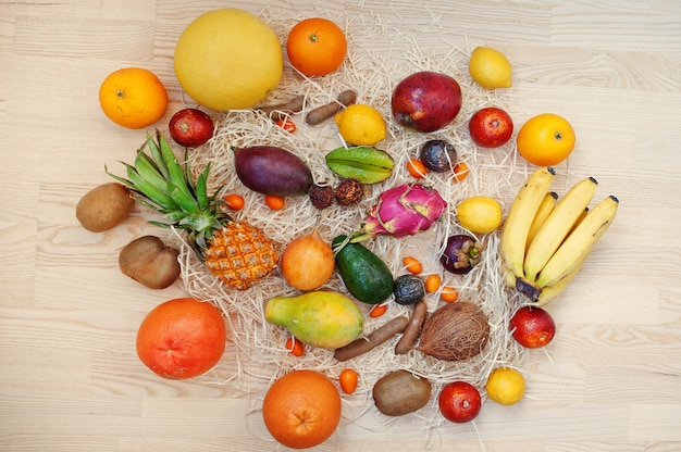 Exotic fruits on wooden background. Premium Photo