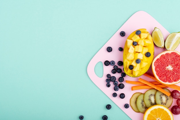 Exotic healthy food on chopping board Free Photo