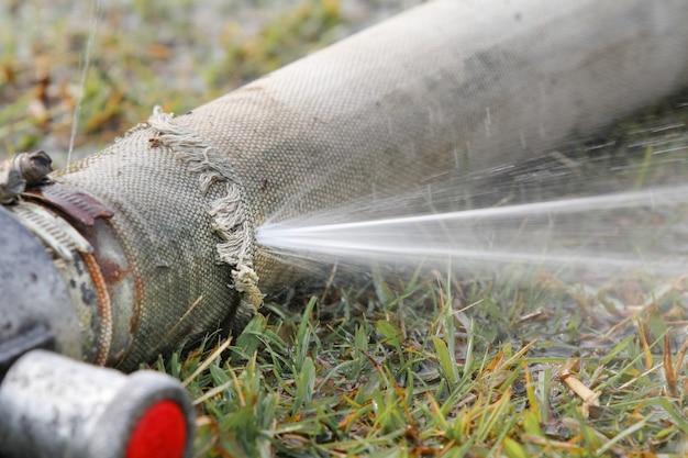 Expired fire hose , water leaking. Premium Photo