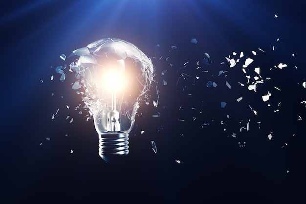 Exploding light bulb on a blue Premium Photo