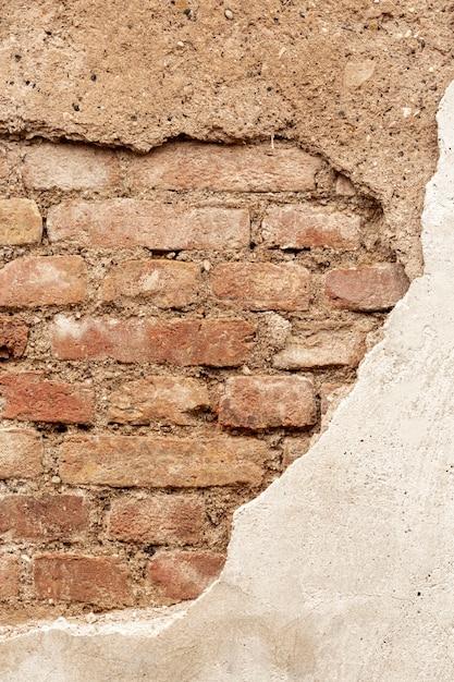 Muro di mattoni a vista con cemento e pietre Foto Gratuite