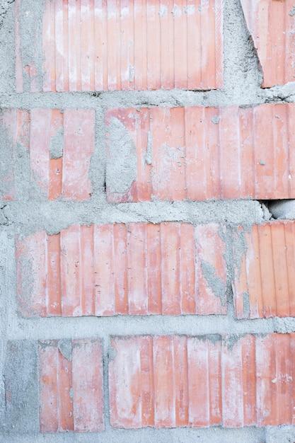 Muro di mattoni a vista con cemento Foto Gratuite