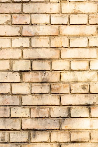 Muro di mattoni sporco esposto Foto Gratuite