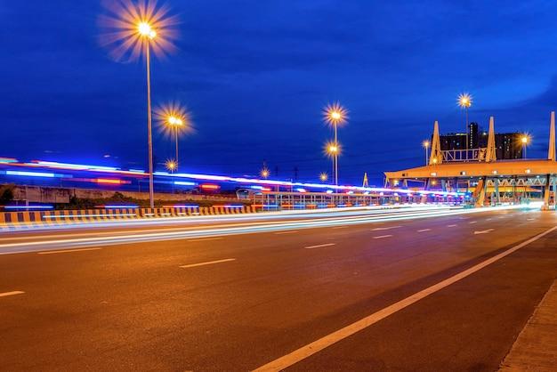 Expressway bridge and traffic at night Premium Photo