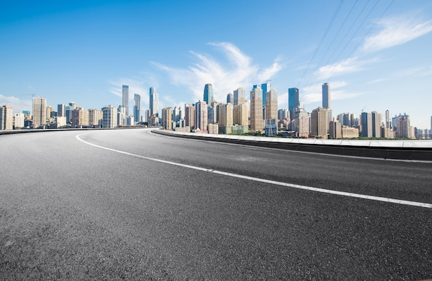 The expressway and the modern city skyline are in chongqing, china. Premium Photo