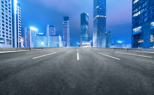 The expressway and the modern city skyline are in guangzhou, china. Premium Photo