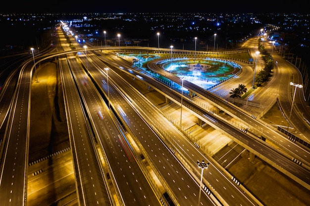 Expressway and ring road connections for transportation and logistics business at night Premium Photo