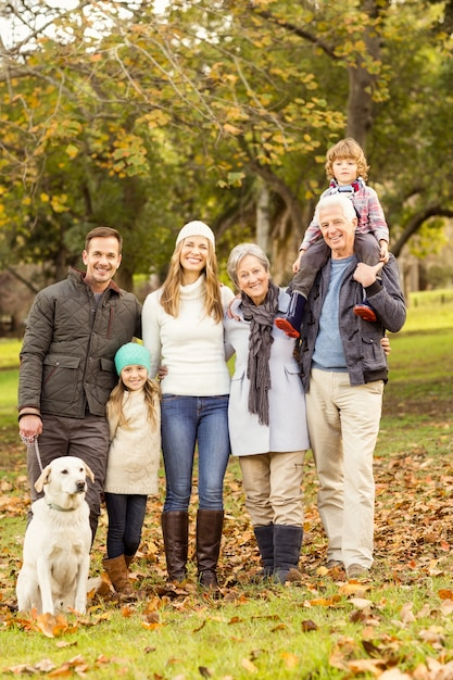 Extended family posing with warm clothes Premium Photo