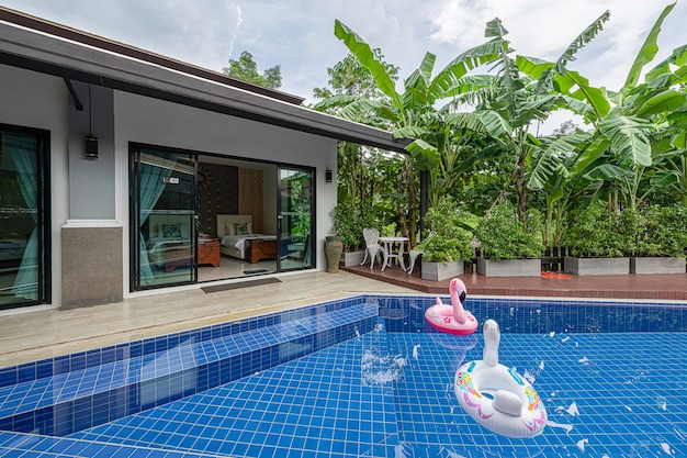 Exterior modern tropical villa with swimming pool Premium Photo