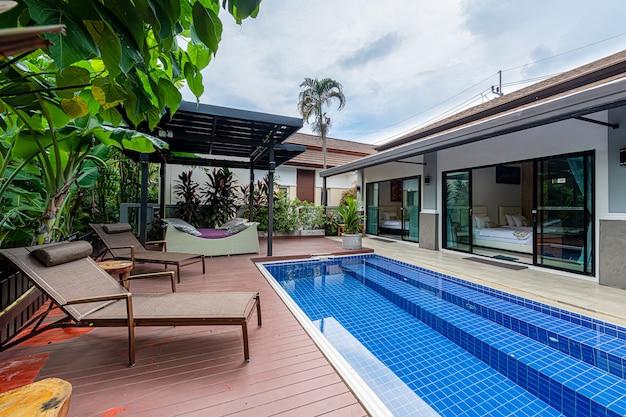 Exterior modern tropical villa with swimming pool Premium Photo