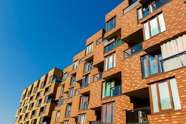 Exterior of new  apartment buildings on a blue sky background Premium Photo