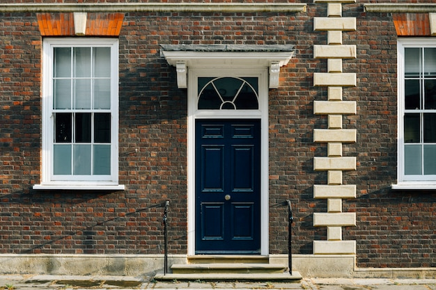 Exterior view of a british townhouse facade Free Photo