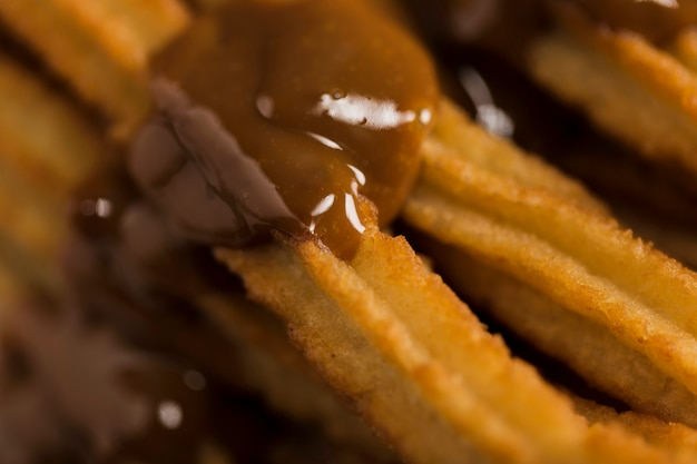 Extreme close-up churros with melted chocolate Free Photo