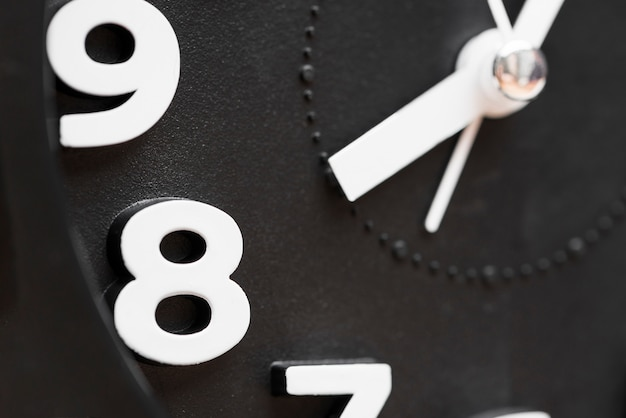 Extreme close-up of clock showing 8'oclock Free Photo