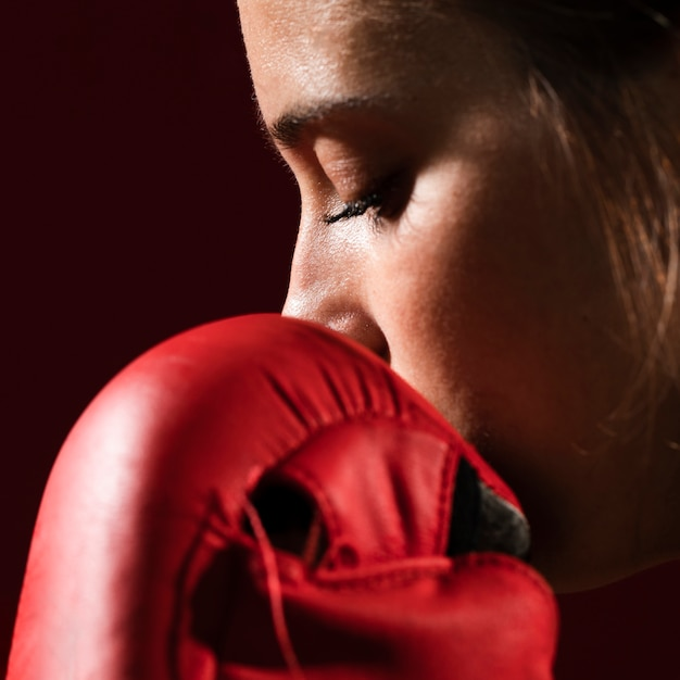 Extreme close-up portrait of a woman with box gloves Free Photo