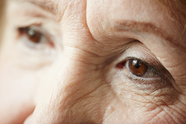 Extreme close-up of sad elderly woman Free Photo