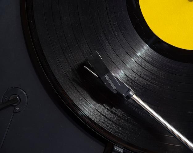 Extreme close-up shot vinyl record playing Free Photo