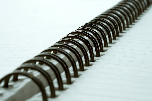 Extreme closeup of a spiral notebook closeup notepad as mockup for your design. Premium Photo