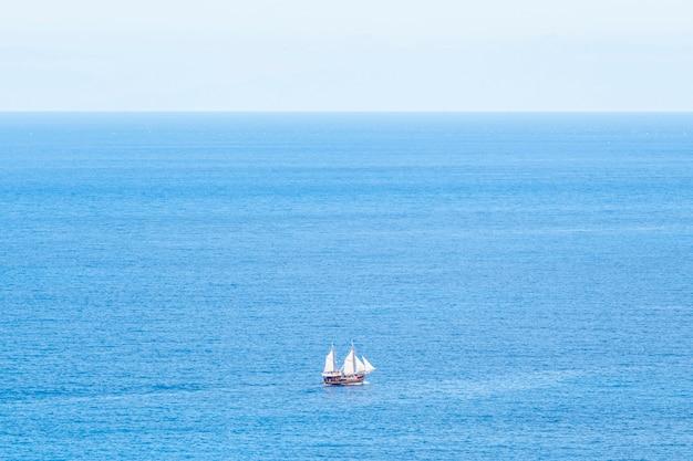 Extreme long shop ship on the sea Free Photo