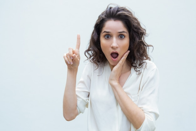 Extremely surprised woman sharing news Free Photo