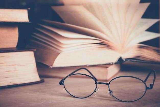 Eye glasses with book Premium Photo