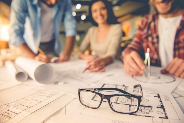 Eyeglasses on drafts, young architects designers teamwork Premium Photo