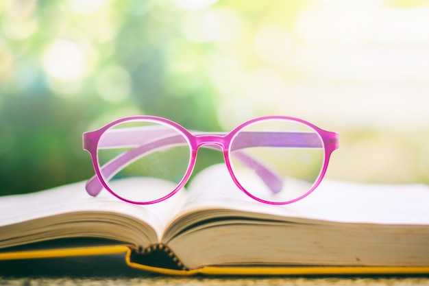 Eyeglasses placed on an opened book Premium Photo