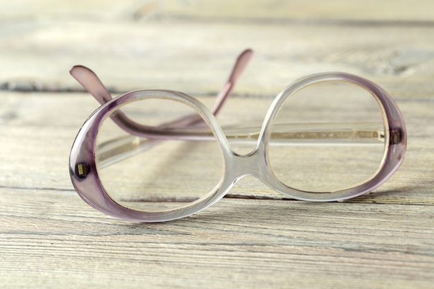 Eyeglasses on wooden table Premium Photo