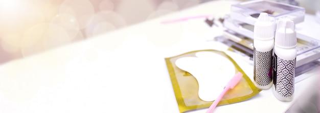 Eyelash extension procedure. tools for eyelash extension. Premium Photo