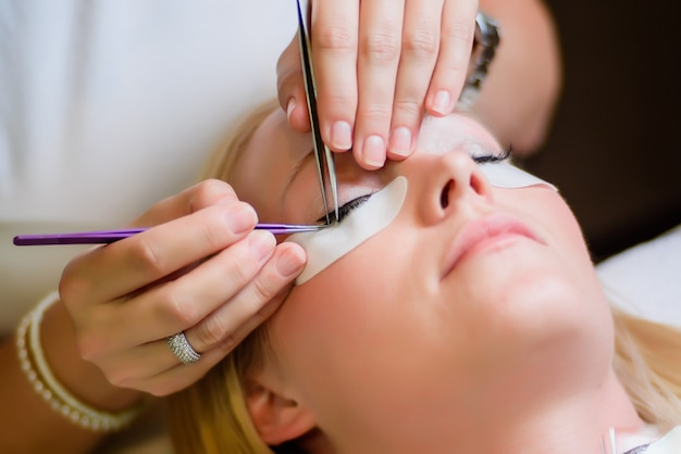 Eyelash extension procedure Premium Photo