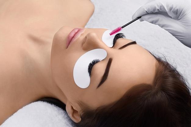 Eyelashes extensions, fake eyelashes, portrait of sexy girl with long fake eyelashes and perfect make-up, Premium Photo