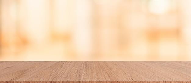 Коричневая деревянная столешница с размытым ресторан бар кафе светлый цвет фона f Premium Фотографии