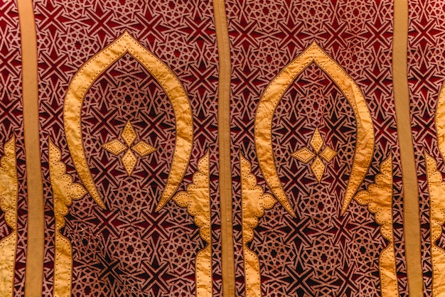 Fabric detail with arabic designs, for background use. Premium Photo