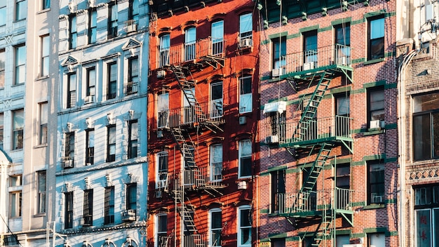 Facades of building with fire escapes Free Photo
