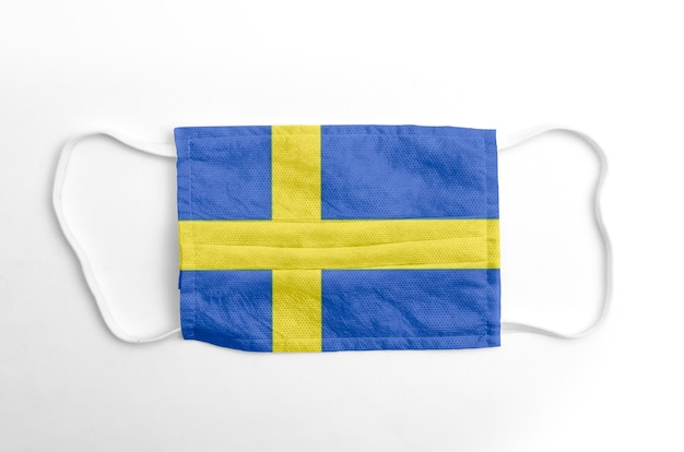 Face mask with printed sweden flag, on white. Premium Photo