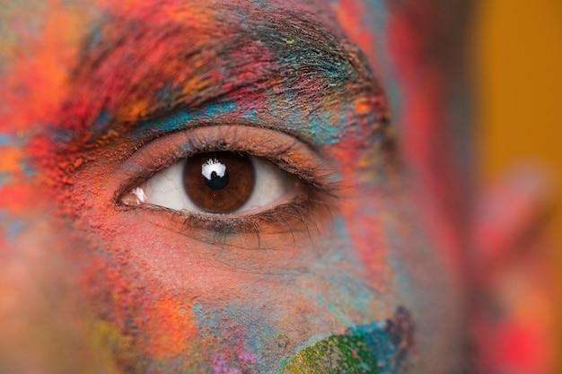 Face in powder paint Premium Photo