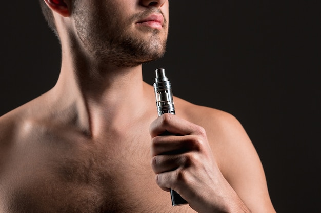 The face of vaping young man Free Photo