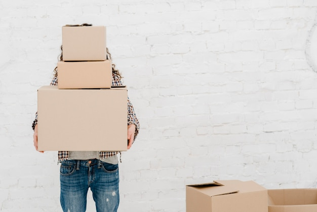 Faceless woman carrying boxes Free Photo