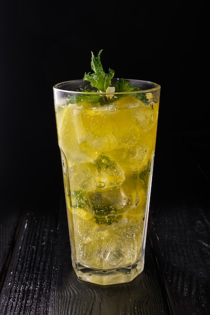 Faceted glass with cold citrus lemonade Premium Photo