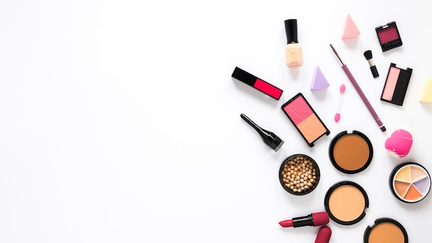 Facial powders with eye shadows and lipstick on table Free Photo