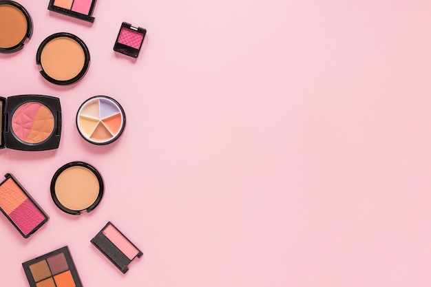Facial powders with eye shadows on table Free Photo