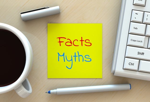 Facts myths, message on note paper, computer and coffee on table, 3d rendering Premium Photo