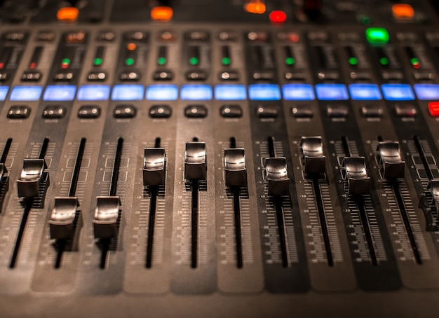 Fader digital mixing console with volume meter Free Photo