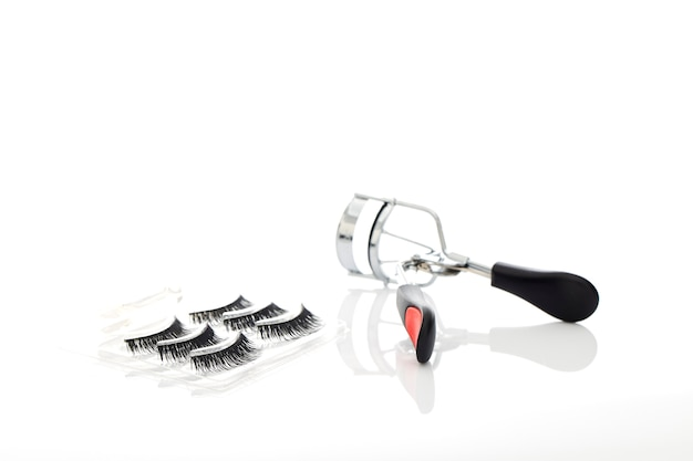 Fake false eyelash with curler on white background Premium Photo