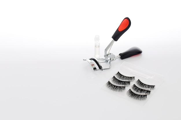 Fake false eyelash with curler Premium Photo