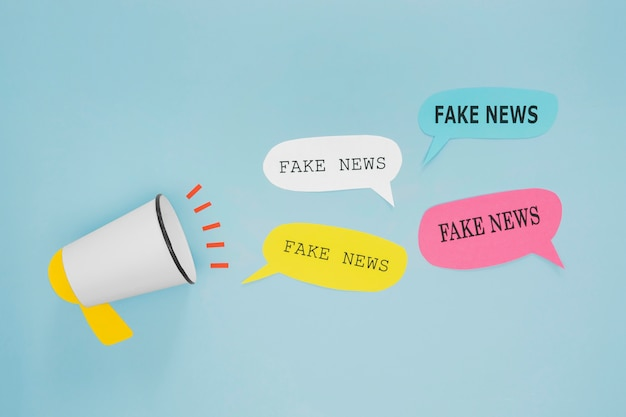Fake news in speech bubbles and megaphone Free Photo