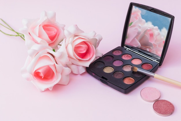 Fake Pink Flowers With Blusher And Eyeshadow Palette With Makeup