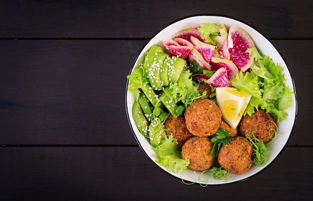 Falafel and fresh vegetables. Premium Photo