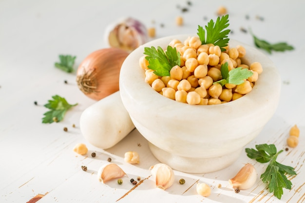 Falafel ingredients on wood table Premium Photo